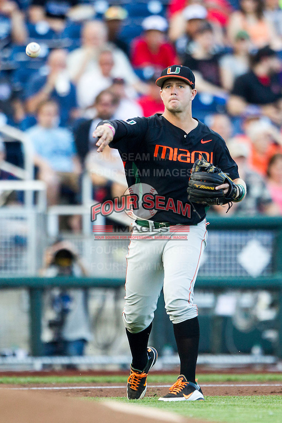 Miami Hurricanes third baseman David Thompson (8) makes a throw to first base against the Florida Gators in the NCAA College World Series on June 13, 2015 at TD Ameritrade Park in Omaha, Nebraska. Florida defeated Miami 15-3. (Andrew Woolley/Four Seam Images)