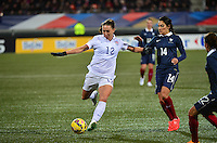 Lorient, France. - Sunday, February 8, 2015:  Lauren Holiday (12) of the USWNT and Louisa Necib (14) of France. France defeated the USWNT 2-0 during an international friendly at the Stade du Moustoir.
