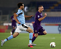 Football, Serie A: S.S. Lazio - Fiorentina, Olympic stadium, Rome, June 27, 2020. <br /> Fiorentina's Frank-Henry Ribéry (r) in action with Lazio's captain Marco Parolo (l) during the Italian Serie A football match between S.S. Lazio and Fiorentina at Rome's Olympic stadium, Rome, on June 27, 2020. <br /> UPDATE IMAGES PRESS/Isabella Bonotto