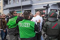 """Ueber 1.000 Rechtsextreme aus mehreren Bundeslaendern demonstrieren am Samstag den 19. August 2017 in Berlin zum Gedenken an den Hitler-Stellvertreter Rudolf Hess.<br /> Rudolf Hess hatte am 17. August 1987 im Alliierten Kriegsverbrechergefaengnis in Berlin Spandau Selbstmord begangen. Seitdem marschieren Rechtsextremisten am Wochenende nach dem Todestag mit sog. """"Hess-Maerschen"""".<br /> Weit ueber 1.000 Menschen protestierten gegen den Aufmarsch der Rechtsextremisten und stoppten den Hess-Marsch nach 300 Metern u.a. mit Sitzblockaden. Der rechtsextreme Aufmarsch wurde daraufhin von der Polizei umgeleitet.<br /> Aus dem Aufmarsch wurden mehrfach Gegendemonstranten angegriffen, mindestens ein Neonazi wurde festgenommen.<br /> Im Bild: Polizeibeamte hindern einen Rechtsextremen an weiteren Angriffen.<br /> 19.8.2017, Berlin<br /> Copyright: Christian-Ditsch.de<br /> [Inhaltsveraendernde Manipulation des Fotos nur nach ausdruecklicher Genehmigung des Fotografen. Vereinbarungen ueber Abtretung von Persoenlichkeitsrechten/Model Release der abgebildeten Person/Personen liegen nicht vor. NO MODEL RELEASE! Nur fuer Redaktionelle Zwecke. Don't publish without copyright Christian-Ditsch.de, Veroeffentlichung nur mit Fotografennennung, sowie gegen Honorar, MwSt. und Beleg. Konto: I N G - D i B a, IBAN DE58500105175400192269, BIC INGDDEFFXXX, Kontakt: post@christian-ditsch.de<br /> Bei der Bearbeitung der Dateiinformationen darf die Urheberkennzeichnung in den EXIF- und  IPTC-Daten nicht entfernt werden, diese sind in digitalen Medien nach §95c UrhG rechtlich geschuetzt. Der Urhebervermerk wird gemaess §13 UrhG verlangt.]"""