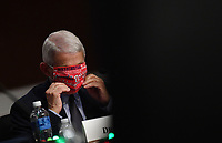 Dr. Anthony Fauci, director of the National Institute for Allergy and Infectious Diseases, adjusts his face mask as he prepares to testify before the Senate Health, Education, Labor and Pensions (HELP) Committee on Capitol Hill in Washington DC on Tuesday, June 30, 2020.  Fauci and other government health officials updated the Senate on how to safely get back to school and the workplace during the COVID-19 pandemic. <br /> Credit: Kevin Dietsch/CNP/AdMedia