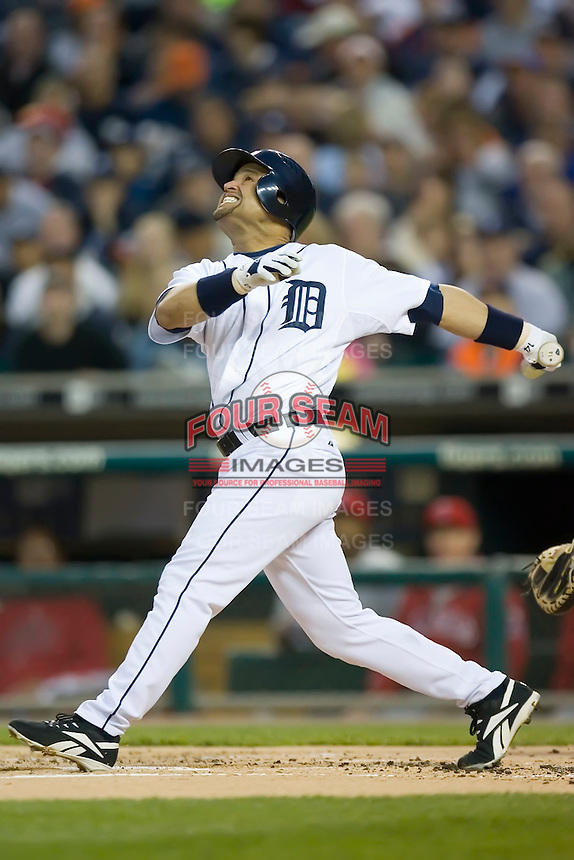 Detroit Tigers' Placido Polanco (14) follows through on his swing versus the Los Angeles Angels at Comerica Park in Detroit, MI, Sunday, April 27, 2008.