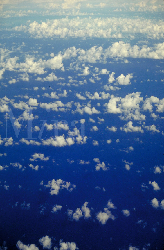 Aerial view of clouds over ocean. Airy, puffy, light, calm, serenity, serene. Connotations - Religious, power, new beginnings.