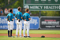 Grand Rapids Dam Breakers Wenceel Perez (23), Gage Workman (27), and Jake Holton (8) during the national anthem before a game against the Fort Wayne TinCaps on August 21, 2021 at LMCU Ballpark in Comstock Park, Michigan.  The West Michigan Whitecaps rebranded for the day as the Grand Rapids Dam Breakers to bring awareness to the Grand River Restoration Project. (Mike Janes/Four Seam Images)
