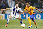 Real Sociedad's Alberto de la Bella (l) and FC Barcelona's  Rafinha Alcantaraduring La Liga match. April 9,2016. (ALTERPHOTOS/Acero)