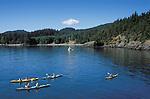 Sea kayaking at Doe Bay, Orcas Island, San Juan Islands, Washington state, USA.