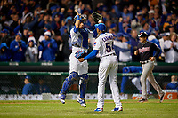 Chicago Cubs pitcher Aroldis Chapman (54) and Willson Contreras (40) celebrate after closing out Game 5 of the Major League Baseball World Series against the Cleveland Indians on October 30, 2016 at Wrigley Field in Chicago, Illinois.  (Mike Janes/Four Seam Images)