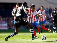 Atletico's Falcao and Granada's Nyom during La Liga BBVA match. April 14, 2013.(ALTERPHOTOS/Alconada)
