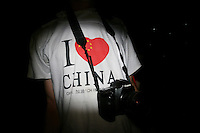 CHINA. Beijing. A man wearing an 'I Love China' t-shirt whilst watching the opening ceremony of the Beijing Summer Olympics. 2008