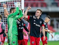 WASHINGTON, DC - APRIL 17: Chris Seitz #1 and Julian Gressel #31 of D.C. United celebrate after a game between New York City FC and D.C. United at Audi Field on April 17, 2021 in Washington, DC.