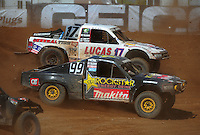 Apr 16, 2011; Surprise, AZ USA; LOORRS driver Kyle Leduc (99) races alongside Carl Renezeder (17) during round 3 at Speedworld Off Road Park. Mandatory Credit: Mark J. Rebilas-.