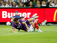 18th April 2021; HBF Park, Perth, Western Australia, Australia; A League Football, Perth Glory versus Wellington Phoenix; Carlo Armiento of the Perth Glory is felled in a heavy tackle by Cameron Devlin of Wellington Phoenix