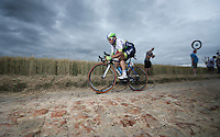 Michael Albasini (SUI/Orica-GreenEDGE) on the cobbled sector of Artres (1200m)<br /> <br /> stage 4: Seraing (BEL) - Cambrai (FR) <br /> 2015 Tour de France