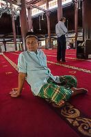 Yogyakarta, Java, Indonesia.  Men Awaiting Noon Prayers, Great Mosque, Masjid Gedhe Kauman, mid-18th. Century.