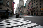 Empty streets and sidewalks are seen along Fifth Avenue in New York, U.S., on Thursday, March 19, 2020. New York state Governor Andrew Cuomo on Thursday ordered businesses to keep 75% of their workforce home as the number of coronavirus cases rises rapidly. Photograph by Michael Nagle/Redux