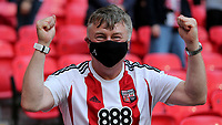 A Brentford fan celebrate promotion to the Premier League during Brentford vs Swansea City, Sky Bet EFL Championship Play-Off Final Football at Wembley Stadium on 29th May 2021