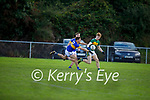 Knocknagoshel's John Bell on a run as Cordals Jason Cronin makes a tackle in the Junior Club football Championship quarter final
