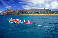Outrigger canoe racing; Outrigger Canoe Club Men's crew, Men's Lanikai Race; Kahala, Oahu, Hawaii..Diamond Head in background