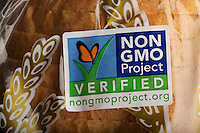 Non-GMO Project sticker on the packaging of a loaf of commercial bread from a natural foods bakery, USA