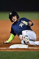 Michael Paez (3) of the Columbia Fireflies slides into third with a triple in a game against the Lexington Legends on Friday, April 21, 2017, at Spirit Communications Park in Columbia, South Carolina. Columbia won, 5-0.(Tom Priddy/Four Seam Images)