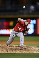 North Carolina State Wolfpack relief pitcher Tommy DeJuneas (42) delivers a pitch to the plate against the Charlotte 49ers at BB&T Ballpark on March 29, 2016 in Charlotte, North Carolina. The Wolfpack defeated the 49ers 7-1.  (Brian Westerholt/Four Seam Images)