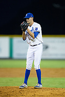 Burlington Royals relief pitcher Michael Messier (17) looks to his catcher for the sign against the Danville Braves at Burlington Athletic Stadium on August 15, 2017 in Burlington, North Carolina.  The Royals defeated the Braves 6-2.  (Brian Westerholt/Four Seam Images)
