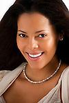 Portrait of beautiful Hispanic woman, looking forward, smiling