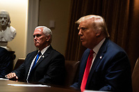 United States Vice President Mike Pence, left, listens during a meeting between US President Donald J. Trump, right, and members of the National Association of Police Organizations Leadership in the Cabinet Room of the White House in Washington, DC, on July 31st, 2020.<br /> Credit: Anna Moneymaker / Pool via CNP /MediaPunch