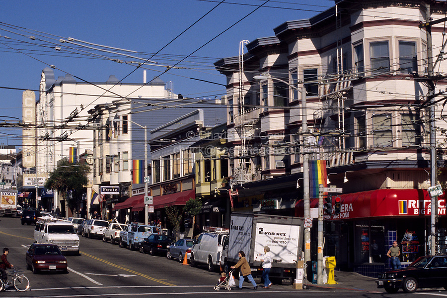 San Francisco, California - Castro Street and 18th Street, Showing Visual Pollution Created by Electric Bus Lines.  Rainbow Banners Denote the Welcome of Gay and Lesbian Life Styles in the Castro District of San Francisco.