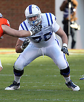 CHARLOTTESVILLE, VA- NOVEMBER 12: Guard John Coleman #70 of the Duke Blue Devils on the line during the game against the Virginia Cavaliers on November 12, 2011 at Scott Stadium in Charlottesville, Virginia. Virginia defeated Duke 31-21. (Photo by Andrew Shurtleff/Getty Images) *** Local Caption *** John Coleman
