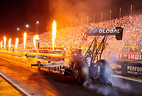 Aug 30, 2019; Clermont, IN, USA; Fire from pyrotechnics go off as NHRA top fuel driver Mike Salinas does a burnout during qualifying for the US Nationals at Lucas Oil Raceway. Mandatory Credit: Mark J. Rebilas-USA TODAY Sports