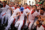 Men argue during the Riau-Riau procession of the San Fermin Festival on July 6, 2012 in Pamplona. The Riau-Riau is a procession held on 6 July in which members of the city council parade from the City Hall to a nearby chapel dedicated to Saint Fermin. The procession was removed from the festival calendar for severql years due to political reasons as extremists used it to promote unrest and clashes with authorities, police and other participants. (c) Pedro Armestre