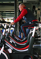 Assistant coach Nigel Gibbs on an exercise bike in the gym during the Swansea City Training at The Fairwood Training Ground, Swansea, Wales, UK. Thursday 10 August 2017