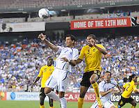 El Salvador midfielder Ramon Sanchez (7) heads the ball against Jamaica forward Ryan Johnson (9)  Jamaica defeated El Salvador 2-0 in a international friendly match at RFK Stadium, Wednesday August 15, 2012.