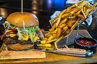 Las Vegas, Nevada.  Bacon Burger, a Specialty at Guy Fieri's Vegas Kitchen and Bar, The Linq Hotel.