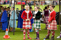 Girls prepare for a Highland dancing competition at the Inveraray Highland Games, held at Inveraray Castle in Argyll.