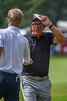 4th July 2021, Detroit, MI, USA;  Phil Mickelson (USA) shakes hands with Will Zalatoris (USA) on 18 following the Rocket Mortgage Classic Rd4 at Detroit Golf Club on July 4,