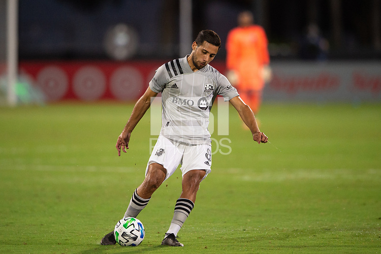 LAKE BUENA VISTA, FL - JULY 25: Saphir Taider #8 of the Montreal Impact kicks the ball during a game between Montreal Impact and Orlando City SC at ESPN Wide World of Sports on July 25, 2020 in Lake Buena Vista, Florida.