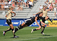 Washington Freedom forward Abby Wambach makes a diving header for what becomes an own goal.  Washington Freedom defeated FC Gold Pride 3-1at the Maryland SoccerPlex, Sunday May 31, 2009.