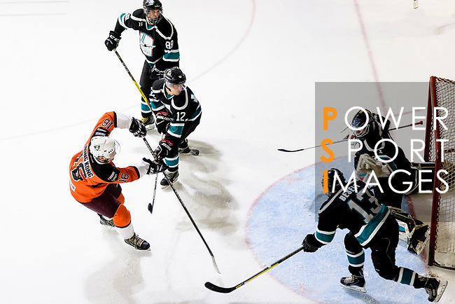 Simon Forgeson of HK Tigers (L) battle in the goal mouth with Cathay Flyers Goalie Jasen Await (R) during the Mega Ice Hockey 5s match between Cathay Flyers and HK Tigers on May 04, 2018 in Hong Kong, Hong Kong. Photo by Marcio Rodrigo Machado / Power Sport Images