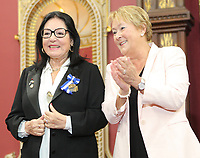 Singer Nana Mouskouri, left, receives the Ordre National du Quebec from Quebec Premier Pauline Marois during a ceremony Tuesday May 28, 2013 at the legislature in Quebec City.<br /> <br /> PHOTO :  Francis Vachon - Agence Quebec Presse