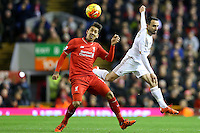 Roberto Firmino competes with Leon Britton during the Barclays Premier League Match between Liverpool and Swansea City played at Anfield, Liverpool on 29th November 2015