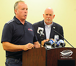 Michael Emhoff, Chairman of the United States Air & Trade Show, left, and Terry Slaybaugh, Director of Aviation for the City of Dayton, address the media at Dayton International Airport on Friday afternoon follow an incident in which an F-16 Fighting Falcon aircraft belonging to the United States Air Force Thunderbirds flipped over with two persons on board.