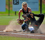 Sparkman High School's Macy West tags Austin's Tara May out as she slides into third base.  Softball tournament.  Sparkman vs. Austin High School at Sparkman.    Bob Gathany / The Huntsville TImes