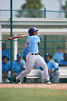 Tampa Bay Rays designated hitter Wander Franco (4) follows through on a swing during an Instructional League game against the Pittsburgh Pirates on October 3, 2017 at Pirate City in Bradenton, Florida.  (Mike Janes/Four Seam Images)