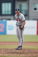 Rome Braves relief pitcher Indigo Diaz (22) looks to his catcher for the sign against the Greensboro Grasshoppers at First National Bank Field on May 16, 2021 in Greensboro, North Carolina. (Brian Westerholt/Four Seam Images)