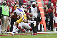 LSU cornerback Jay Ward (5) tackles Arkansas wide receiver Mike Woods (8) resulting in a pass interference, Saturday, November 21, 2020 during the third quarter of a football game at Donald W. Reynolds Razorback Stadium in Fayetteville. Check out nwaonline.com/201122Daily/ for today's photo gallery. <br /> (NWA Democrat-Gazette/Charlie Kaijo)
