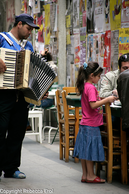 Roma gypsy street musician playing the accordion for the restaurants in Beyoglu, Istanbul, Turkey