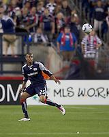 New England Revolution defender Darrius Barnes (25) heads the ball. The New England Revolution defeated Houston Dynamo, 1-0, at Gillette Stadium on August 14, 2010.