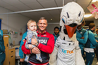 Thursday 21 December 2017<br /> Pictured: Lee Trundle and Cyril the Swan<br /> Re: Swansea City Childrens Ward Visit, Morriston Hospital, Swansea, Wales, UK